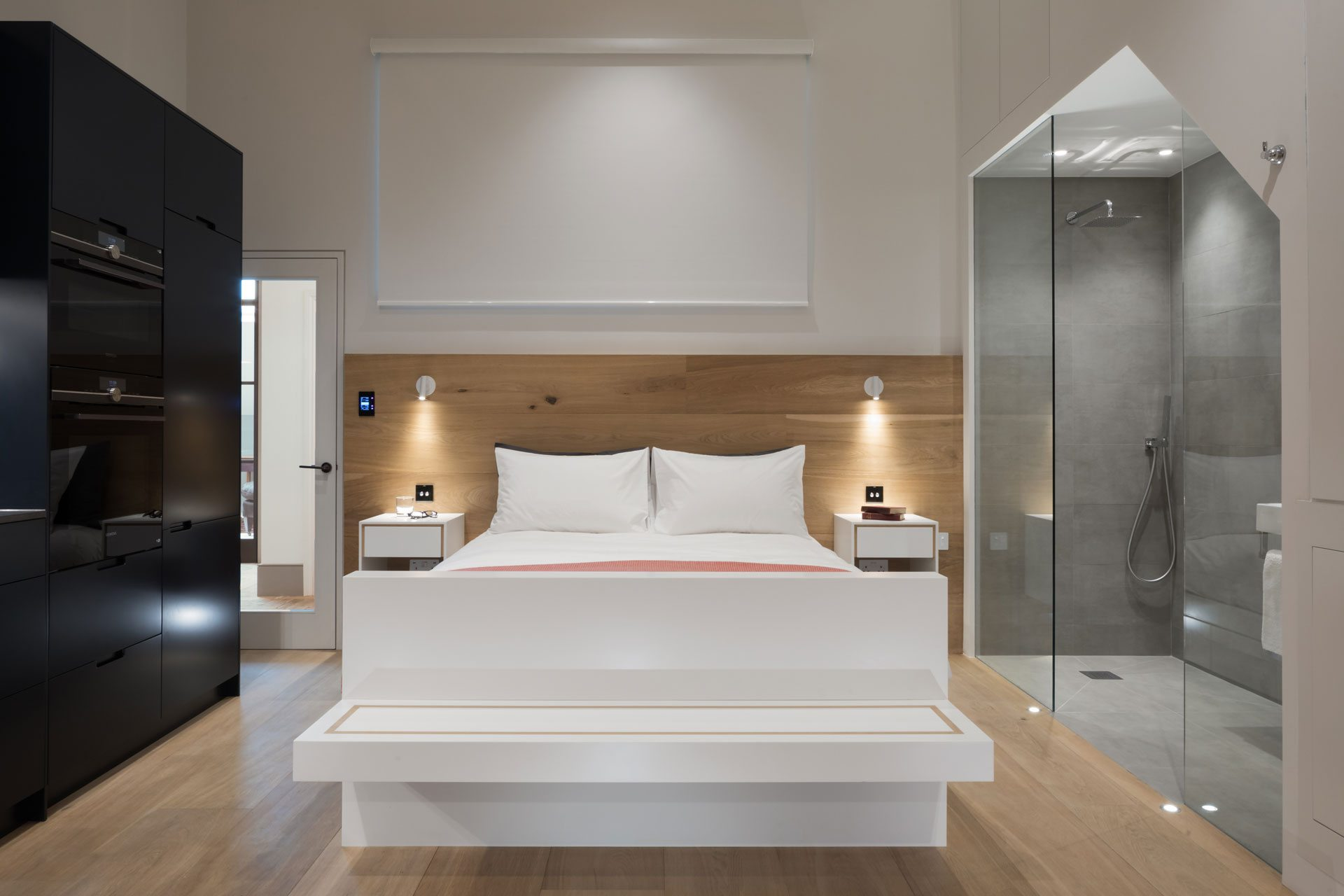modern contemporary bedroom with built in rainfall shower