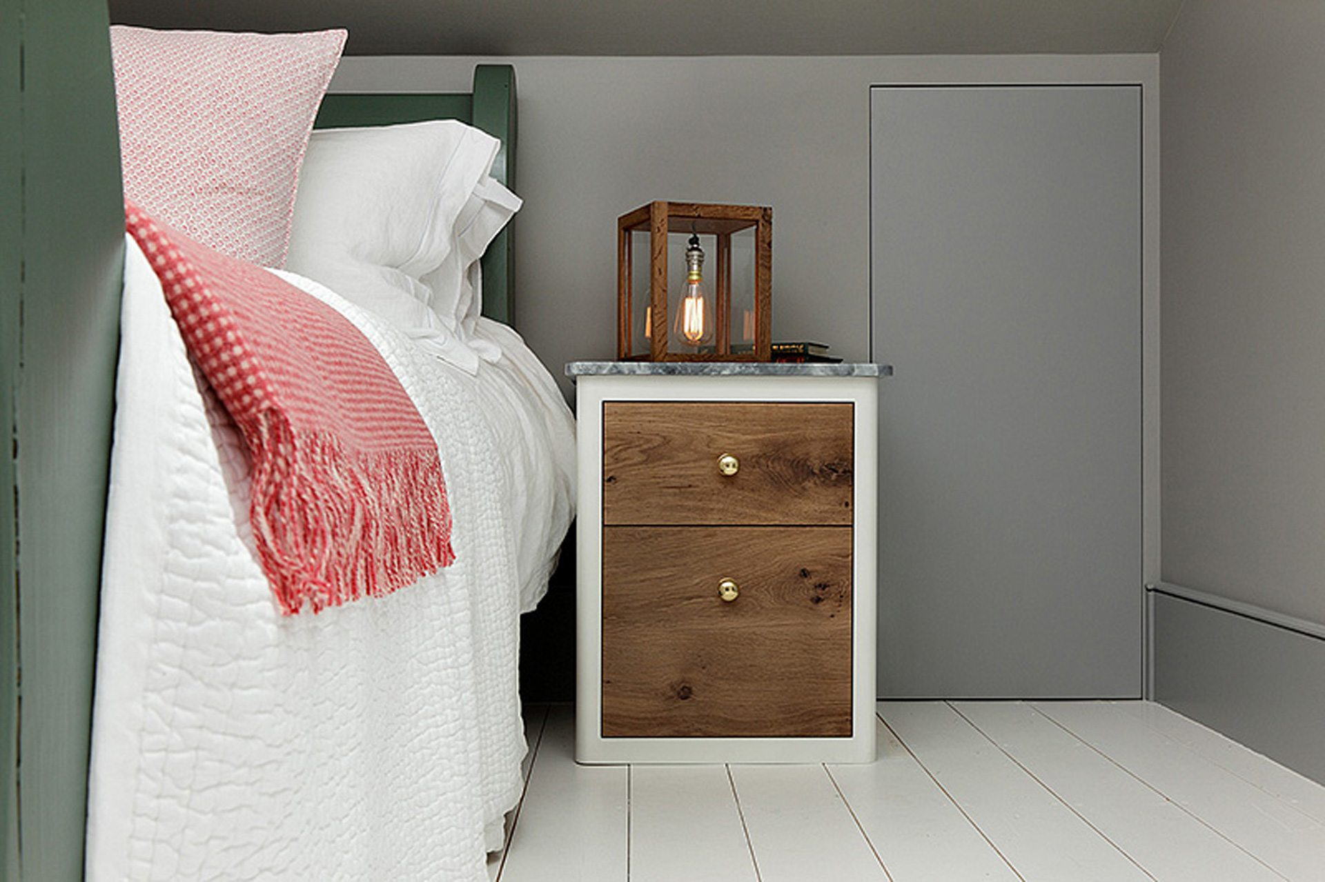bedside table with contemporary table lamp